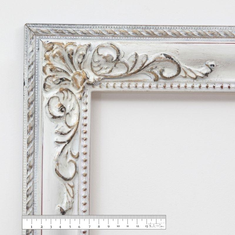 marco a medida blanco decapé con adornos en las esquinas